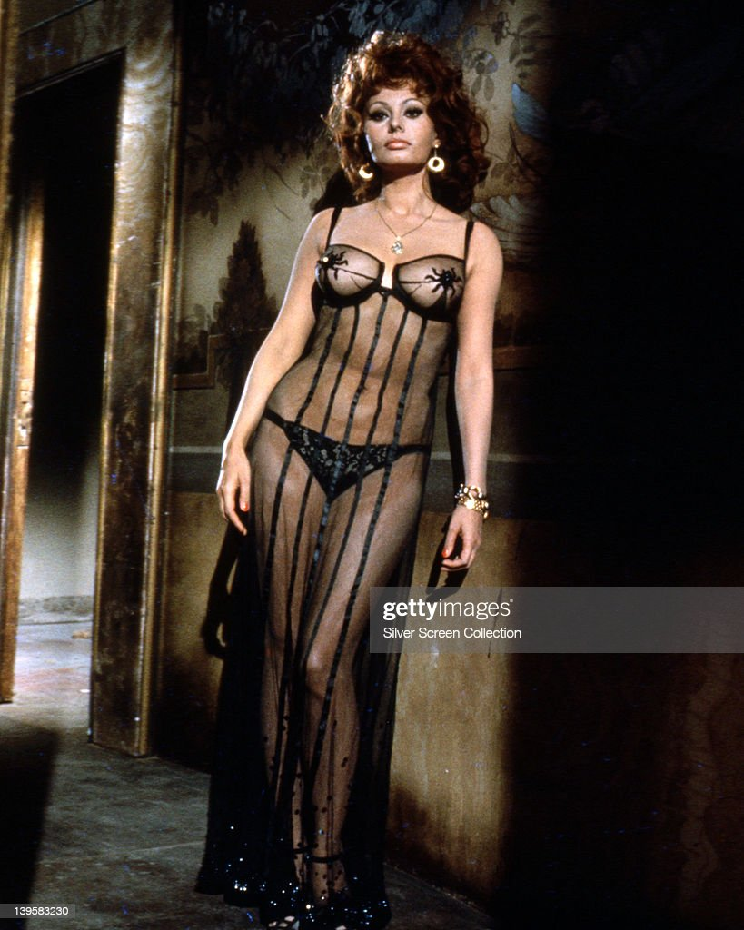 Full length portrait of <a gi-track='captionPersonalityLinkClicked' href=/galleries/search?phrase=Sophia+Loren&family=editorial&specificpeople=94097 ng-click='$event.stopPropagation()'>Sophia Loren</a>, Italian actress, wearing sheer black gown over black underwear, circa 1955.