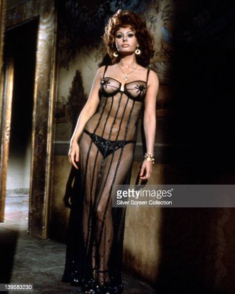 Full length portrait of Sophia Loren Italian actress wearing sheer black gown over black underwear circa 1955