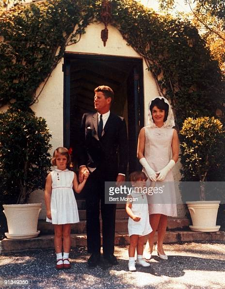 A full length portrait of US president John F Kennedy with first lady Jacqueline Kennedy and their children Caroline and John Jr standing outside in...