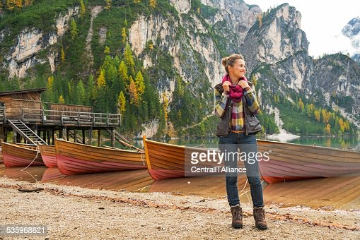 Full length portrait of young woman on lake braies, italy : Stock Photo
