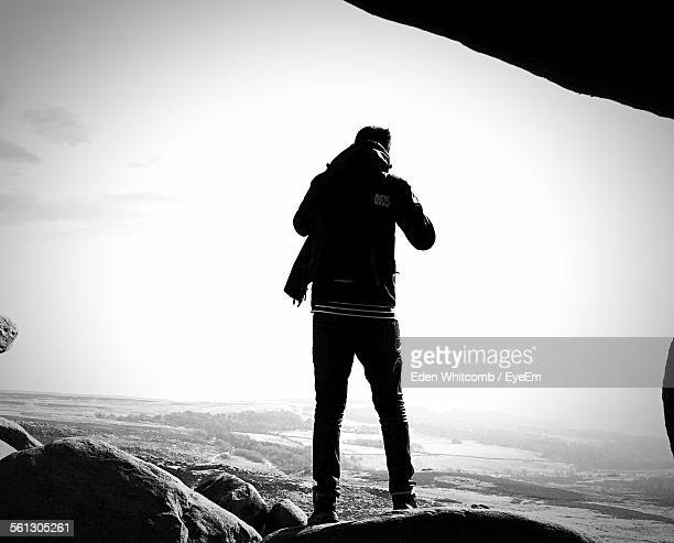Full Length Rear View Of Man Looking At View Through Mountain