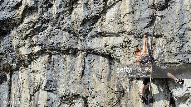 Full Length Rear View Of Woman Climbing Rock