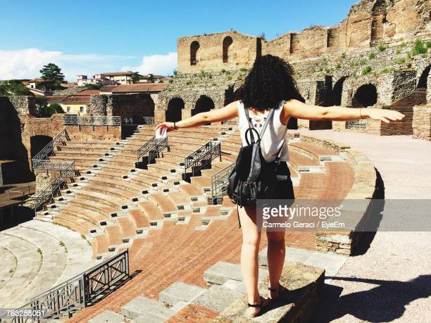 Full Length Rear View Of Woman Standing At Amphitheater