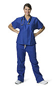 full length shot of a young adult female in blue scrubs as she smiles at the camera