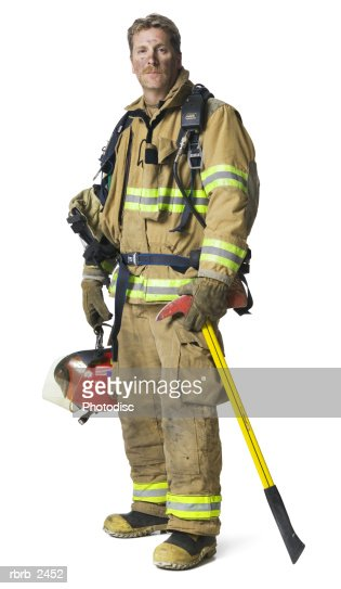 full length shot of an adult male fireman in his gear as he smiles