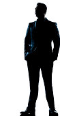 one caucasian  business man  handsome full suit standing full length serious silhouette in studio   white background