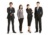 Full Length Studio Portrait Of Chinese Business Team