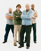 Full Length Studio Portrait of Four Serious Men of Mixed Ages