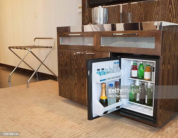 A full mini bar in a hotel room