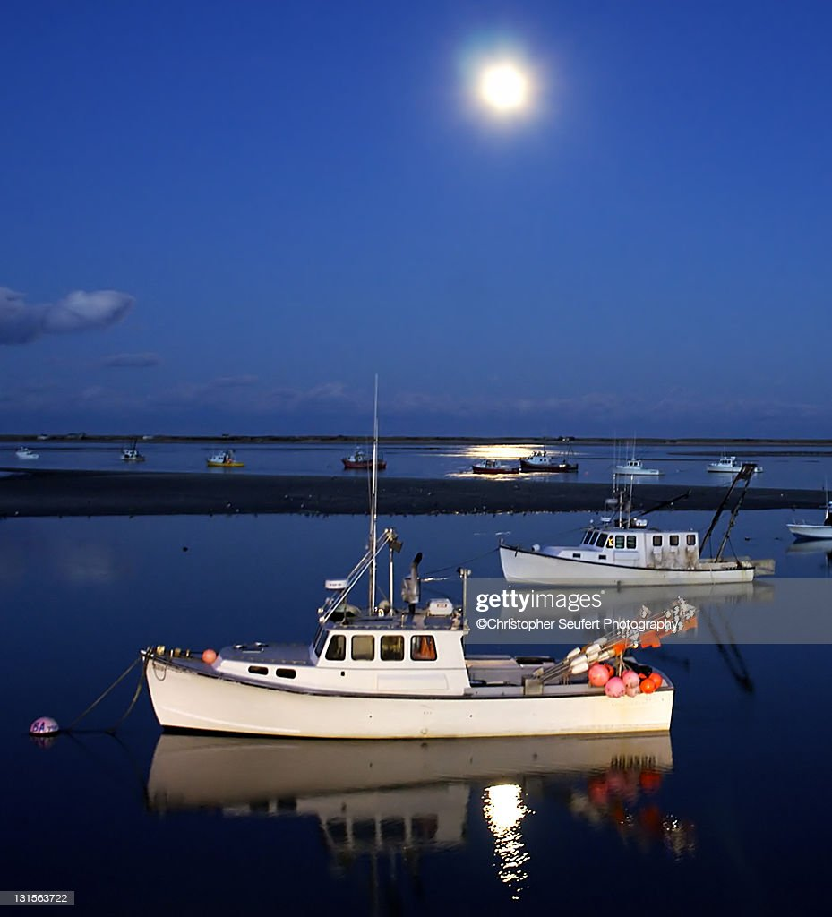 Full moon and fishing boats at night stock photo getty for Ma fishing license cost