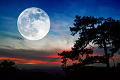 Full moon and sunset on mountain in thailand