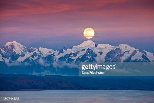 Full moon at Lago Titikaka with Cordillera Real Bolivia