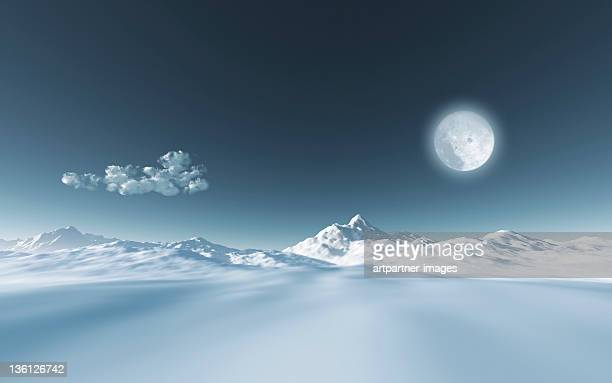 Full moon in a blue sky above snowy landscape