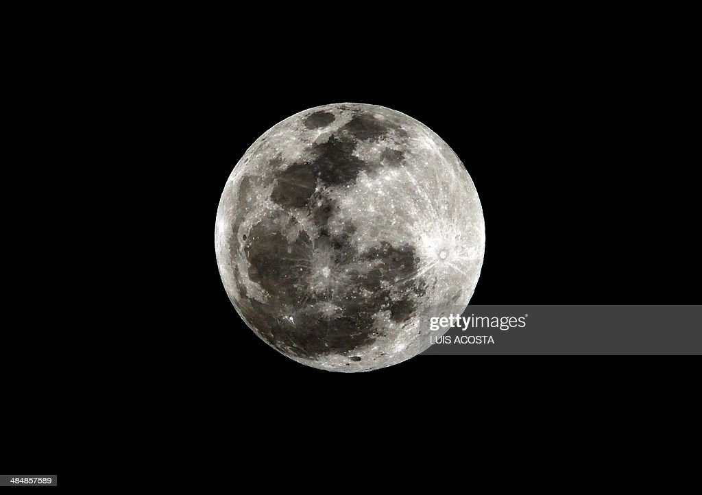 Full moon is seen before a total lunar eclipse in Bogota, Colombia on April 15, 2012.AFP PHOTO/Luis Acosta