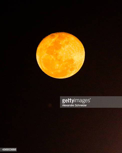 Full Moon is seen during the match between Santos and Bahia for the Brazilian Series A 2014 at Vila Belmiro stadium on October 9 2014 in Santos Brazil