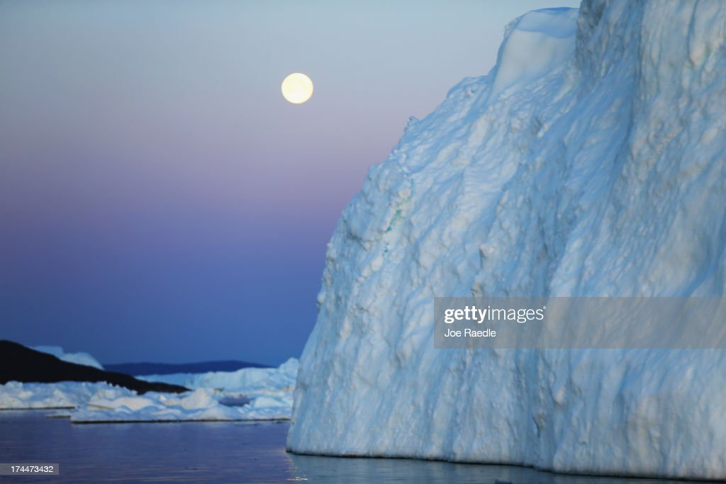 A full moon is seen over an iceberg that broke off from the Jakobshavn Glacier on July 23, 2013 in Ilulissat, Greenland. As the sea levels around the globe rise, researchers affilitated with the National Science Foundation and other organizations are studying the phenomena of the melting glaciers and its long-term ramifications. The warmer temperatures that have had an effect on the glaciers in Greenland also have altered the ways in which the local populace farm, fish, hunt and even travel across land. In recent years, sea level rise in places such as Miami Beach has led to increased street flooding and prompted leaders such as New York City Mayor Michael Bloomberg to propose a $19.5 billion plan to boost the citys capacity to withstand future extreme weather events by, among other things, devising mechanisms to withstand flooding.