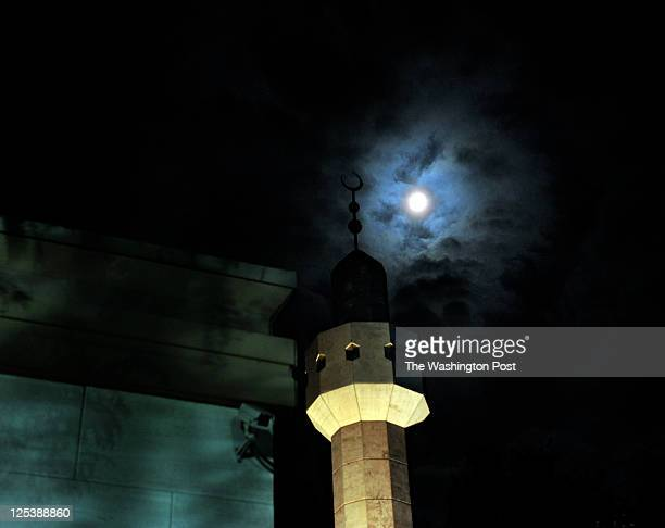 A full moon lingers over the minaret past midnight after Friday evening Ramadan prayers at the Dar alHijrah Mosque on Aug 13 in Falls Church VA The...
