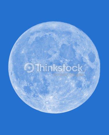 full moon on daylight blue sky background stock photo thinkstock