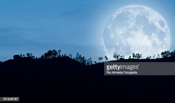 Full moon over the hills