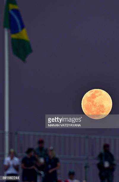 Full moon raises during the women's semifinal field hockey New Zealand vs Britain match of the Rio 2016 Olympics Games at the Olympic Hockey Centre...