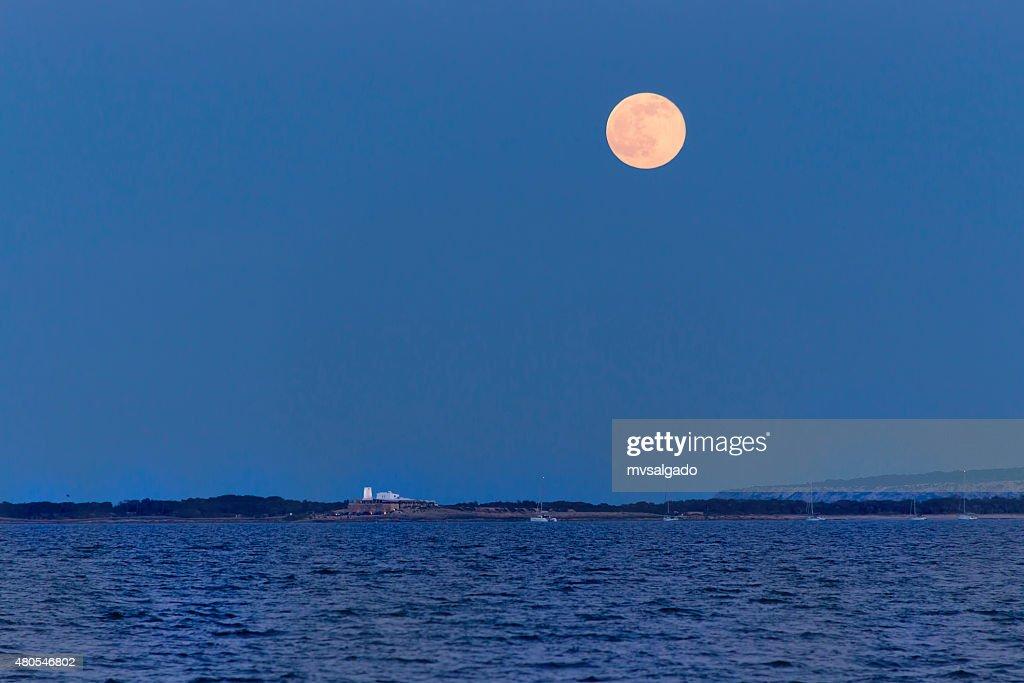 Full moon rising over Illetas : Stock Photo