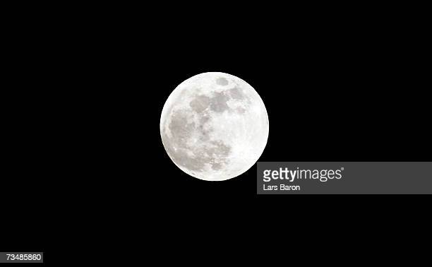 A full moon sits in the nights sky prior to the total lunar eclipse on March 3 2007 in Dinslaken Germany The eclipse began at 2018 GMT with the Moon...