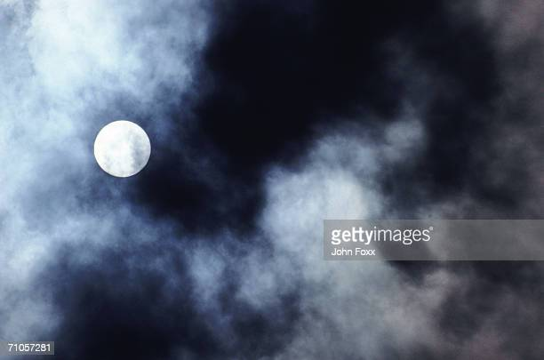 full moon through clouds