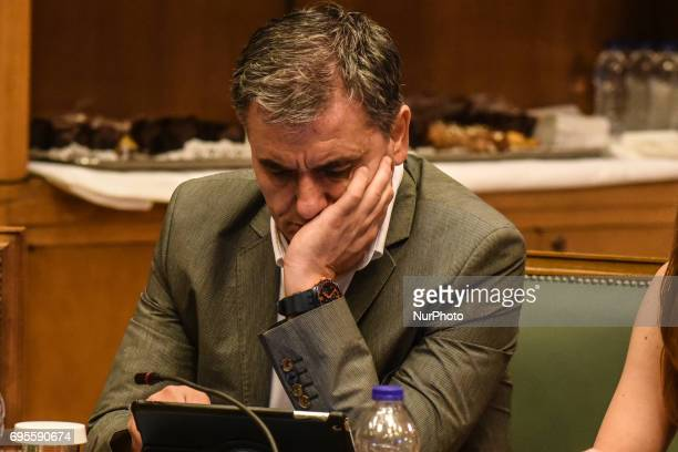Full of sorrows Minister of Finance Euclid Tsakalotos attends Extraordinary cabinet meeting chaired by Prime Minister Alexis Tsipras in Athens on 13...