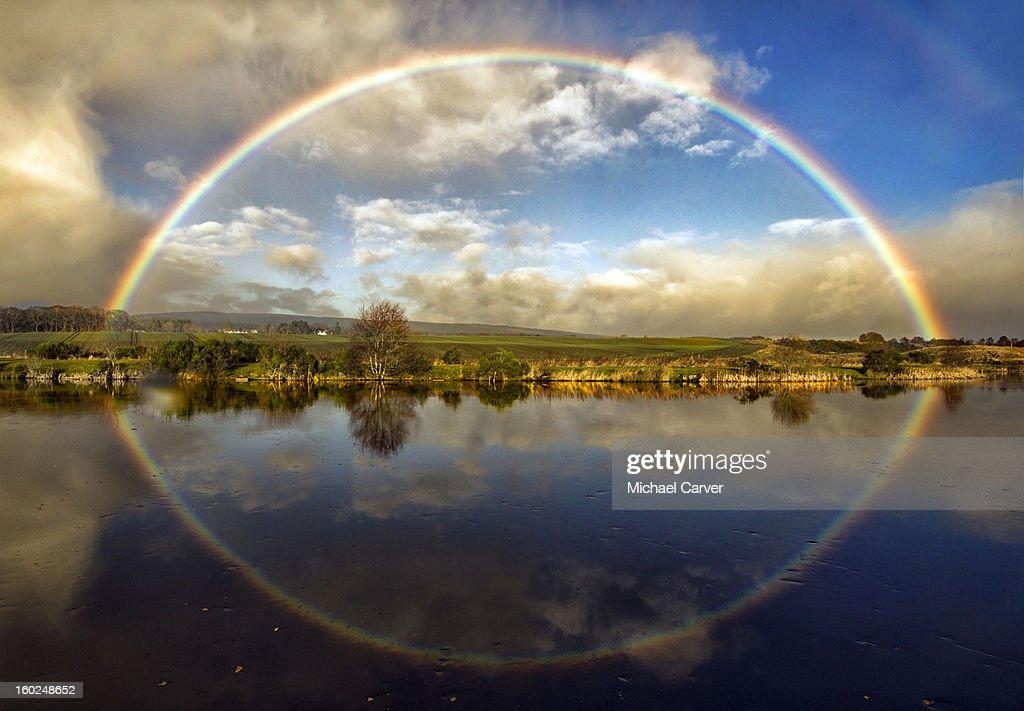 Full Rainbow setting sun : Stock Photo