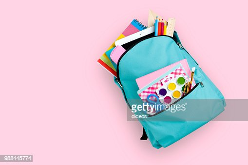 Full school backpack isolated on pink background : Stock Photo