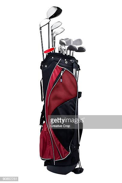 Full set of golf clubs held in a golf bag