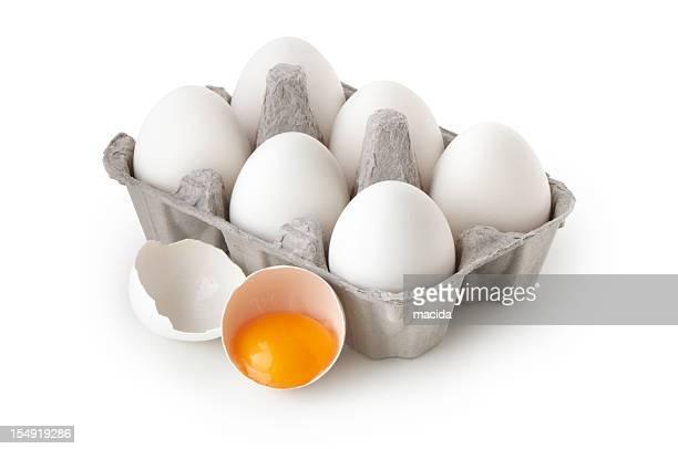 Full six egg carton with a broken egg beside it