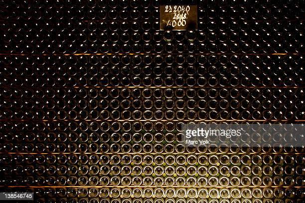 Full stack of champagne bottles