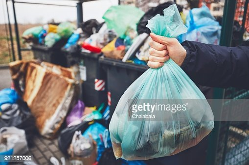 Full trash cans with rubbish bags : Stock Photo
