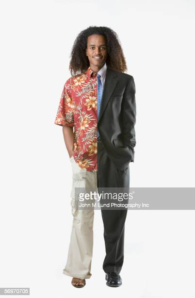 Full view portrait of man half casual, half business