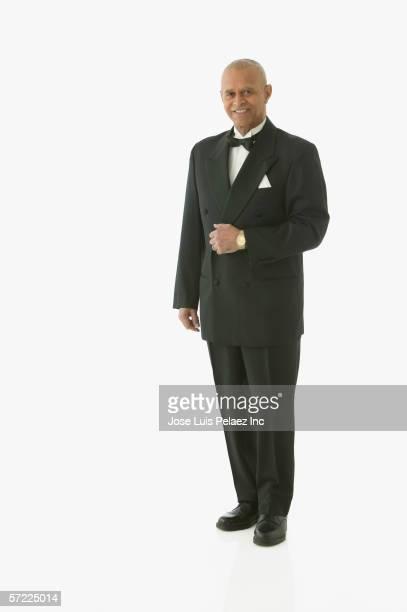 Full view portrait of man in tuxedo