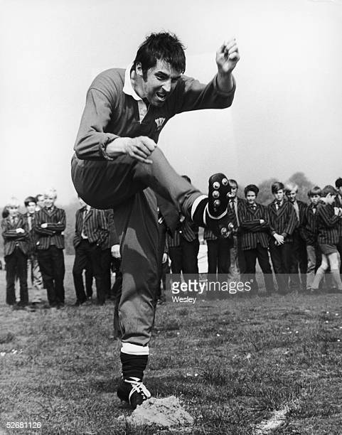 Fullback Bob Hiller practises his goal kicks in front of a group of local schoolboys during a training session at Eastbourne 6th May 1971 The next...