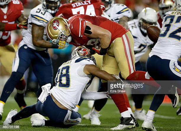Fullback Bruce Miller of the San Francisco 49ers fumbles the ball in the first quarter as he is hit by strong safety Marcus Gilchrist of the San...