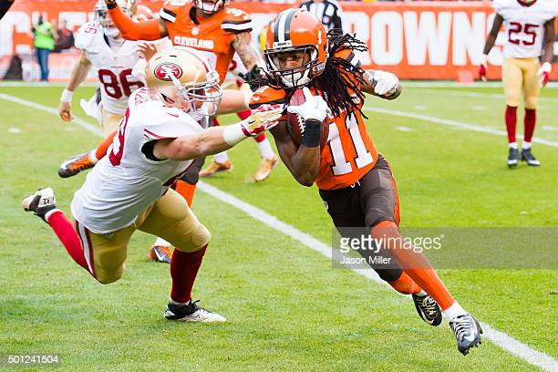 Fullback Bruce Miller of the San Francisco 49ers tries to tackle wide receiver Travis Benjamin of the Cleveland Browns during the second half at...