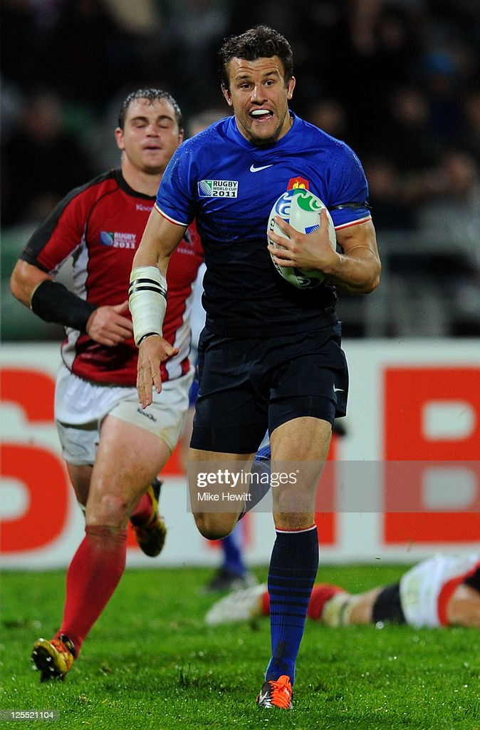 Fullback <a gi-track='captionPersonalityLinkClicked' href=/galleries/search?phrase=Damien+Traille&family=editorial&specificpeople=211328 ng-click='$event.stopPropagation()'>Damien Traille</a> of France breaks away to score his team's second try during the IRB 2011 Rugby World Cup Pool A match between France and Canada at McLean Park on September 18, 2011 in Napier, New Zealand.