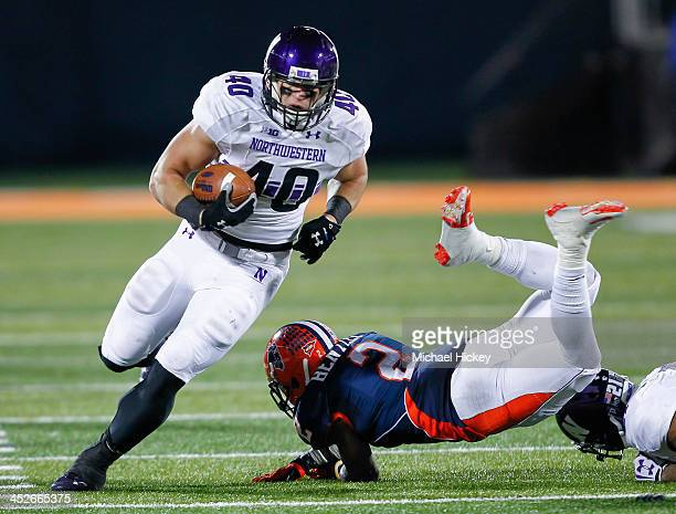 Fullback Dan Vitale of the Northwestern Wildcats runs the ball as defensive back V'Angelo Bentley of the Illinois Fighting Illini stumbles at...