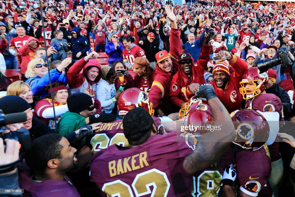 Fullback <a gi-track='captionPersonalityLinkClicked' href=/galleries/search?phrase=Darrel+Young&family=editorial&specificpeople=7410783 ng-click='$event.stopPropagation()'>Darrel Young</a> #36 of the Washington Redskins (C) is mobbed by teammates and fans after scoring the game winning touchdown in overtime to give the Redskins a 30-24 win over the San Diego Chargers at FedExField on November 3, 2013 in Landover, Maryland.