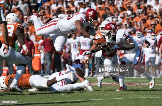 Fullback Dimitri Flowers of the Oklahoma Sooners leaps over the line of scrimmage for the first down during the Oklahoma Sooners and the Texas...