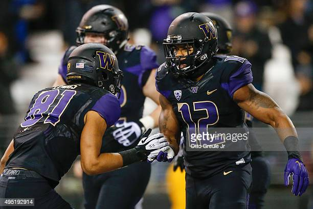 Fullback Dwayne Washington of the Washington Huskies celebrates with wide receiver Brayden Lenius after scoring a touchdown against the Arizona...