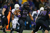 Fullback Dwayne Washington of the Washington Huskies rushes against the Arizona Wildcats on October 31 2015 at Husky Stadium in Seattle Washington