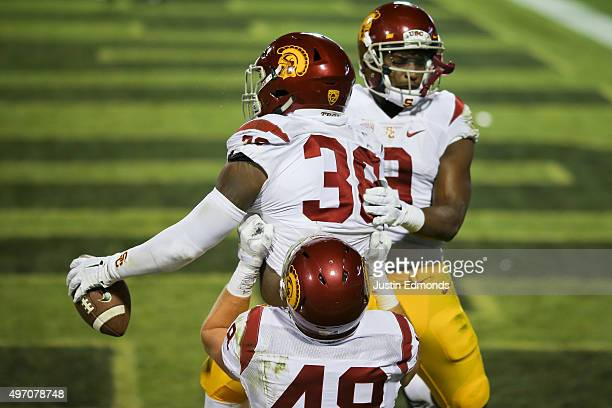Fullback Jahleel Pinner of the USC Trojans celebrates his third quarter touchdown with tight end Taylor McNamara and wide receiver JuJu SmithSchuster...