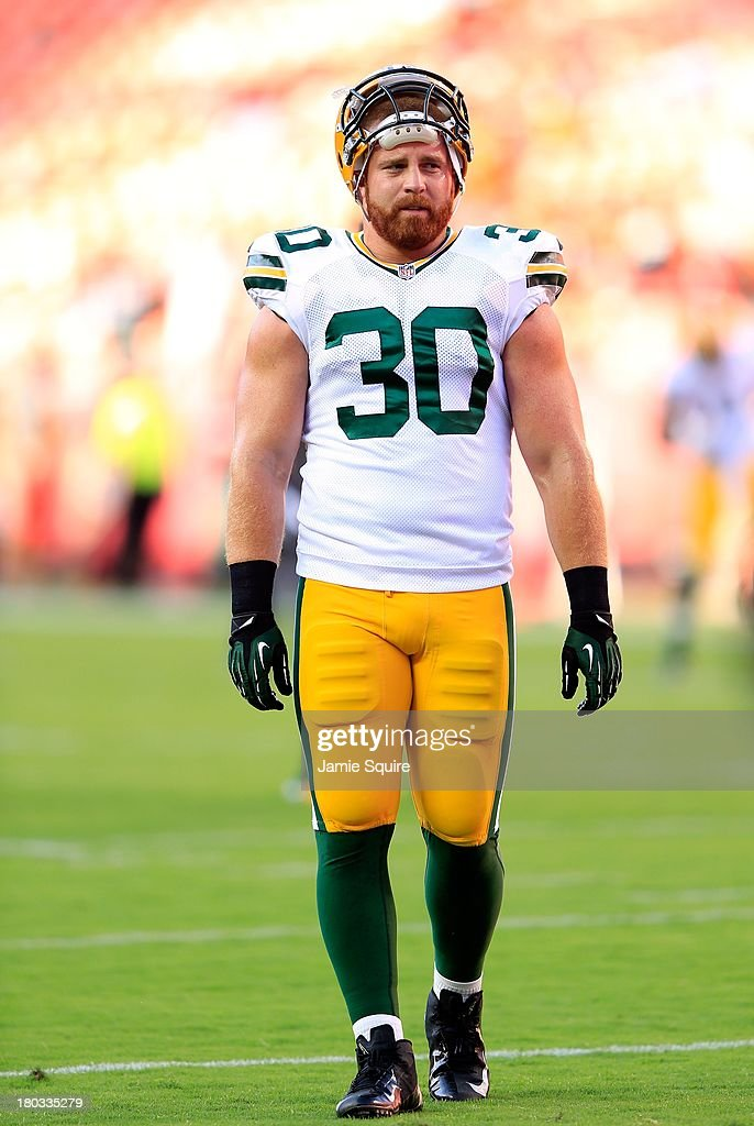 Fullback <a gi-track='captionPersonalityLinkClicked' href=/galleries/search?phrase=John+Kuhn&family=editorial&specificpeople=748674 ng-click='$event.stopPropagation()'>John Kuhn</a> #30 of the Green Bay Packers warms up prior to the preseason game against the Kansas City Chiefs at Arrowhead Stadium on August 29, 2013 in Kansas City, Missouri.