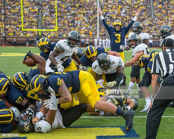 Fullback Khalid Hill of the Michigan Wolverines scores a touchdown in the first quarter during a college football game against the UCF Knights at...