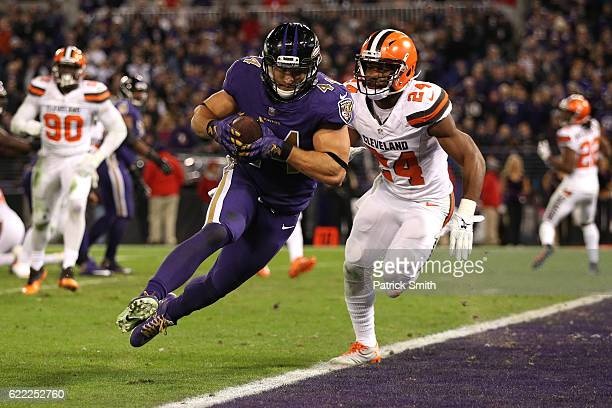 Fullback Kyle Juszczyk of the Baltimore Ravens scores a twopoint conversion past strong safety Ibraheim Campbell of the Cleveland Browns in the third...