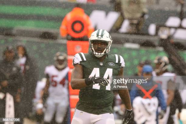 Fullback Lawrence Thomas of the New York Jets in action against the Atlanta Falcons in a heavy rain storm during their game at MetLife Stadium on...